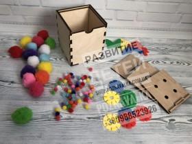 Развивающая коробочка